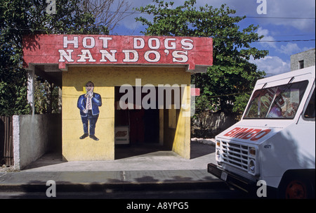 hot dogs bar and a parked van on the road in Cozumel Mexico - Stock Photo