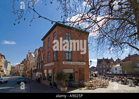 Horizontal wide angle of a canal side brasserie with chairs and tables for customers to sit out in the sun. - Stock Photo
