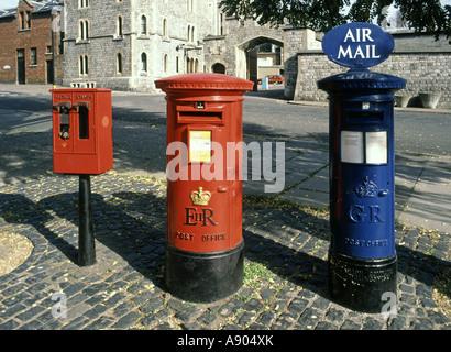 Windsor Berkshire traditional red pillar box & stamp dispensing machine alongside blue airmail post box - Stock Photo