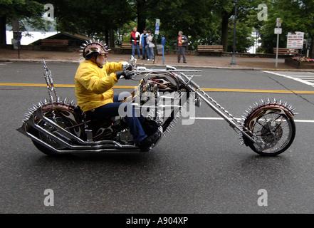 Lake George, NY. Americade Bike rally. Scott Ellis cruises Main Street on his custom chopper made from Honda 1981 - Stock Photo