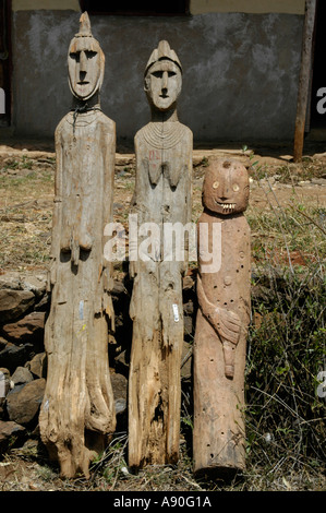 Three ancient wooden totem figures museum Konso Ethiopia - Stock Photo