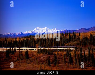 Holland America McKinley Explorer southbound train and the Alaska Range. - Stock Photo