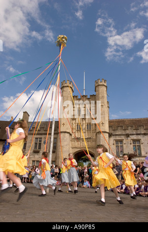 England Somerset Wells Market Place May Day dancing round the Maypole in the sunshine - Stock Photo