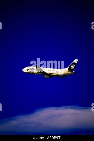 Alaska Airlines B 737 400 on climb out from Kotzebue Airport in northwest Alaska - Stock Photo
