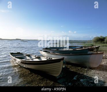 fishing boats lying on the  shore of an irish lake, beauty in nature, - Stock Photo