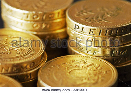 A stack of old style UK Pound Coins - Stock Photo