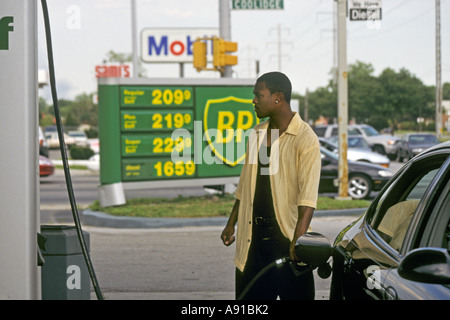 Royal Oak Township Michigan A man pumps gasoline at a BP gas station with prices above 2 00 a gallon - Stock Photo