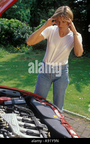 woman stressed by car that won't start - Stock Photo