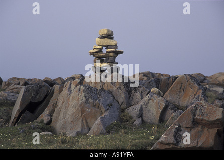 NA, Canada, Manitoba, near Churchill, Inukshuk, a stone cairn built by Inuit as a marker on the tundra - Stock Photo