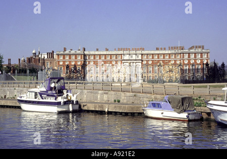 Hampton Court Palace London & River Thames seen from pleasure boat trip with views of the gilded gates and south - Stock Photo