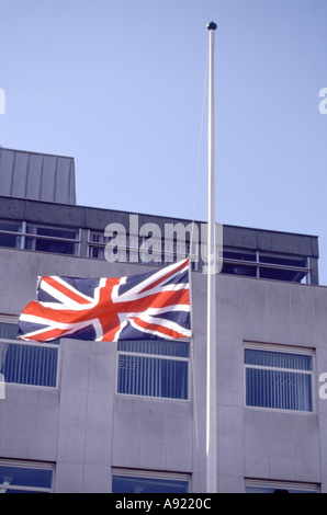 Chelmsford Essex Union Jack flag flying at half mast at time of national mourning - Stock Photo