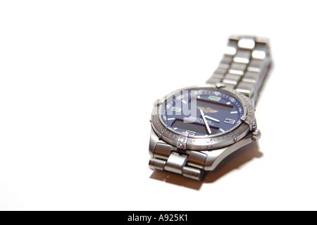 Breitling Aerospace repetition minutes titanium gents wristwatch white background - Stock Photo