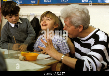 A teachers works on numbers with younGBoy at a South London preparatory school - Stock Photo