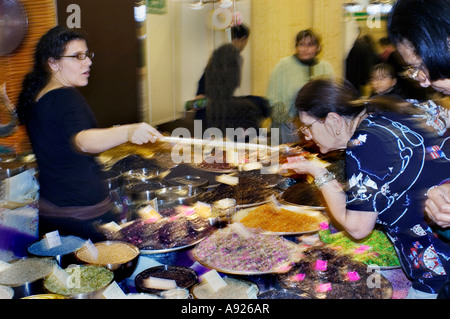 Paris France, Woman Selling 'Herbs and Spices' at 'La Route des Indes' Exhibit at 'Trade Show' Shopping saleswoman - Stock Photo