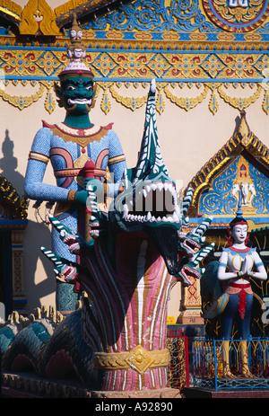 MALAYSIA Penang Georgetown Wat Buppharam or Chayamangkalaram Sleeping Buddha Temple Thai style temple Guardians - Stock Photo
