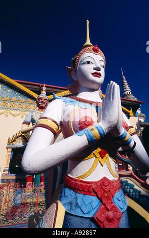 MALAYSIA Penang Georgetown Wat Buppharam or Chayamangkalaram Sleeping Buddha Temple Statues at the entrance of Thai - Stock Photo