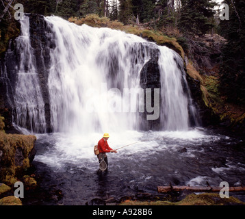 Trout fisherman below Fall Creek Falls on the Green Lakes Trail in the Cascade Mountains of Oregon - Stock Photo