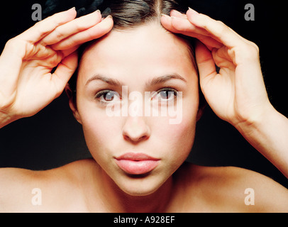 YOUNG WOMAN LOOKING THROUGH GLASS - Stock Photo