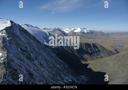 View at a chain of snow covered mountains above the steppe Kharkhiraa Mongolian Altai near Ulaangom Uvs Aymag Mongolia - Stock Photo