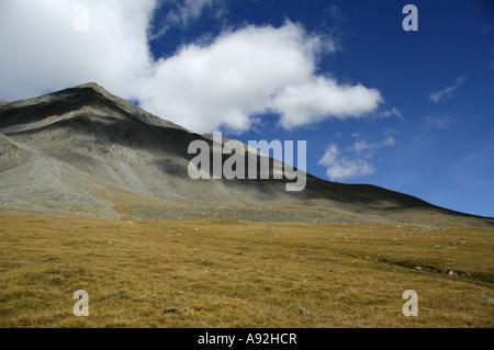 Clouds above a mountain in the steppe Kharkhiraa Mongolian Altai near Ulaangom Uvs Aymag Mongolia - Stock Photo