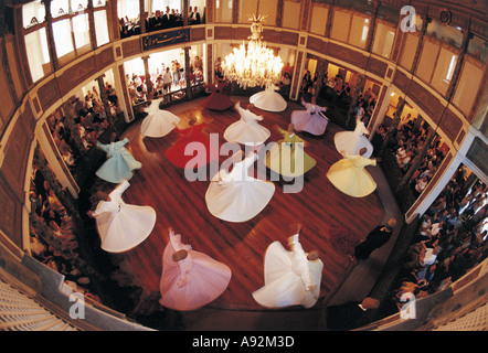 Women whirling dervishes in Galata Mevlevihanesi Istanbul Turkey - Stock Photo