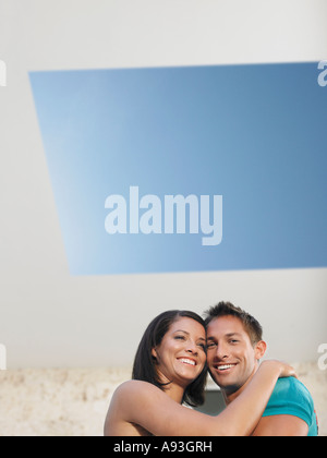 Affectionate Young Couple Under Skylight - Stock Photo