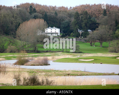 View over part of the Celtic Manor golf course in lower Usk Valley toward large detached house Newport South Wales - Stock Photo