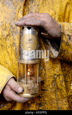 Coal miner with lamp at the newly re opened Unity Mine Cwmgwrach near Neath Wales UK GB EU - Stock Photo