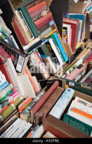 Jumble of second hand books for sale on market stall England UK - Stock Photo