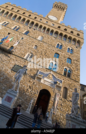 Vertical close up of the entrance and campanile of the Palazzo Vecchio on a bright sunny day - Stock Photo
