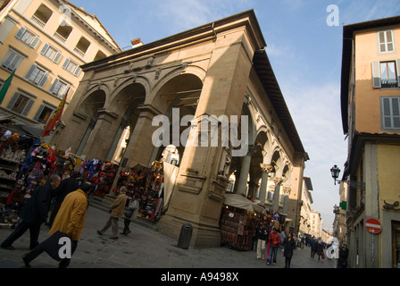 Horizontal angular view of the many stalls of Italian leather goods set up at the Mercato Nuovo 'New market'. - Stock Photo