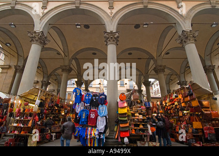 Horizontal angular view of the many stalls of Italian leather goods set up at the Mercato Nuovo 'New market'. - Stock Photo