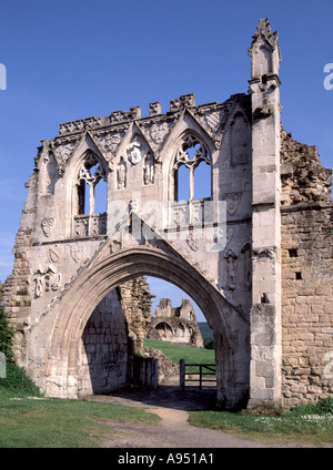 Historical ruins at Kirkham Priory gatehouse entrance arch English Gothic medieval architecture with ruins beyond - Stock Photo