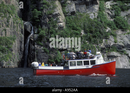 Tour boat in fijord at Gros Morne National Park Newfoundland - Stock Photo
