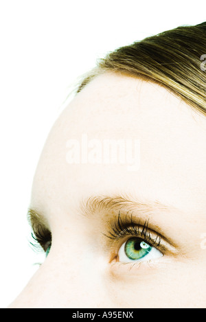 Teenage girl, close-up of eyes and forehead - Stock Photo