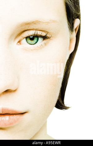 Teenage girl's face, cropped front view - Stock Photo