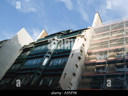 Apartment buildings, one with scaffolding, low angle view - Stock Photo