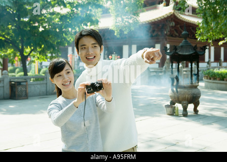Young couple taking photo Stock Photo