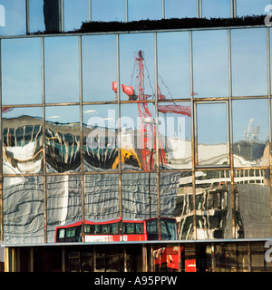 London regeneration construction reflected in glass window - Stock Photo