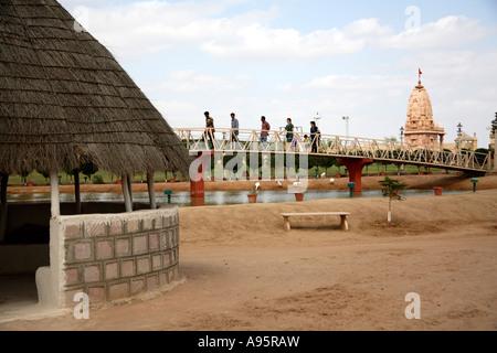 People crossing bridge at Hiralaxmi Memorial Craft Park, Bhujodi Village, Kutch, Gujarat, India - Stock Photo