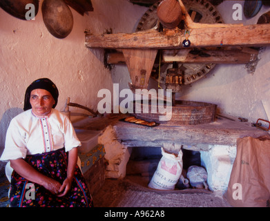 Greece Karpathos A Miller s wife inside a working windmill in Olympos Village - Stock Photo