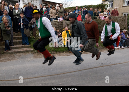 Traditional Easter Good Fiday skipping. The Rose Cottage Inn. Alciston,  Sussex, England. 2006. Photograph by Homer - Stock Photo