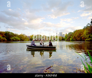 New Yorkers enjoy the early evening at a boating lake in Central Park New York, USA - Stock Photo
