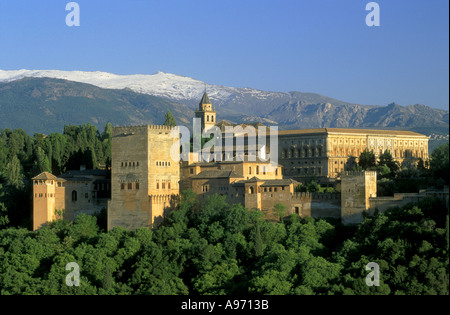 Alhambra Moorish Fortress and Sierra Nevada moutains in spring late evening Granada Andalucia Spain Europe - Stock Photo
