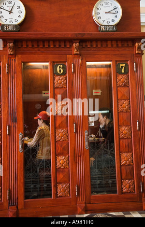 Wooden telephone booths in Post Office, Ho Chi Minh City (Saigon), Vietnam - Stock Photo