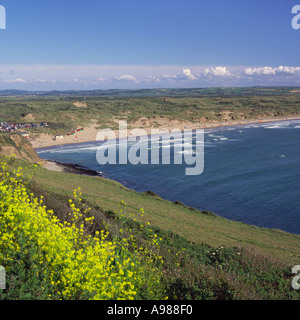 View looking South over Saunton Sands and Braunton Burrows Nature Reserve with small surf North Devon England - Stock Photo