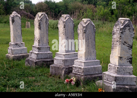 HEADSTONES IN CEMETERY AT SPRING RANCH, A GHOST TOWN ALONG THE OREGON TRAIL, S.E. NEBRASKA. SUMMER. - Stock Photo
