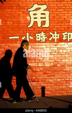 California, San Francisco, Walter E Lum Place, Chinatown, man walking - Stock Photo
