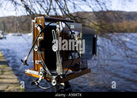 Photographer using Vintage Large Format camera .Taking photos Bowness on Windermere Lake Windermere UK England Cumbria - Stock Photo