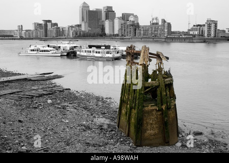 ABANDONED TARDIS. Decrepit wooden jetty structure at  Bermondsey in London.  'Colour-popped' black-and-white image. - Stock Photo